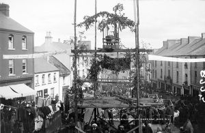 "Puck Fair in full flight in this photo with King Puck (An Puc Rí) installed on his ""throne,"" 1900. National Library of Ireland on The Commons."