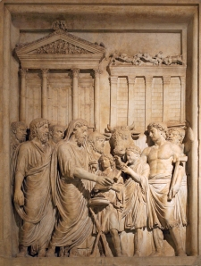 Emperor Marcus Aurelius (161-180 AD) and members of the Imperial family offer sacrifice in gratitude for success against Germanic tribes. In the backgrounds stands the Temple of Jupiter on the Capitolium (this is the only extant portrayal of this roman temple). Bas-relief from the Arch of Marcus Aurelius, Rome, now in the Capitoline Museum in Rome.