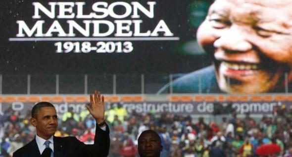 U.S. President Barack Obama addresses the crowd during a memorial service for Nelson Mandela at FNB Stadium in Johannesburg, South Africa December 10, 2013. World leaders, from U.S. President Barack Obama to Cuba's Raul Castro, will pay homage to Mandela at the memorial that will recall his gift for bringing enemies together across political and racial divides. REUTERS/Kevin Lamarque (SOUTH AFRICA - Tags: POLITICS OBITUARY) - RTX16C5M