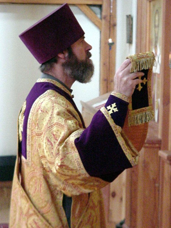Deacon singing the Great Litany at St. Elias Ukrainian Greek Catholic Church, Brompton ON. (Please click to learn how to help rebuild the Church.)